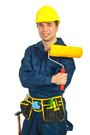 Happy worker man holdig paint roller against white background photo