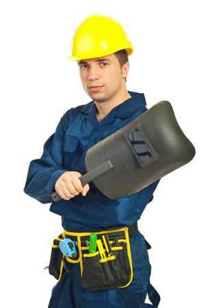 kaynakçı: Young welder man holding welding mask isolated on white background Stok Fotoğraf