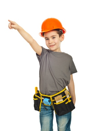 Little constructor worker boy pointing up isolated on white background photo