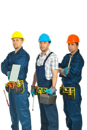 Team of constructors workers standing in a row and holding tools isolated on white background photo