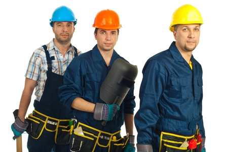 Teamwork of three builders men isolated on white background photo
