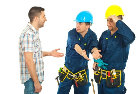explanations: Constructor workers team giving explanations to client  isolated on white background Stock Photo