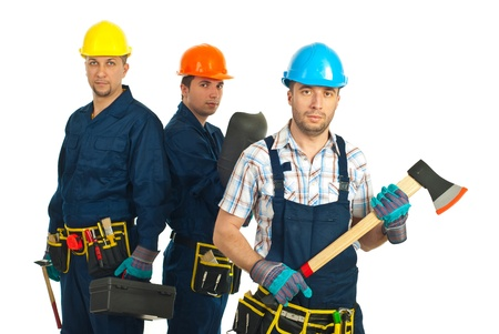 Mid adult constructor worker holding axe in front of image and his team in background photo