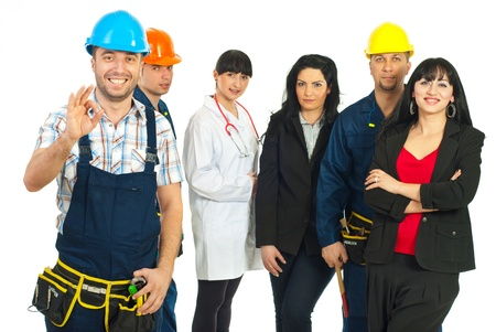 Happy constructor worker showing okay sign hand gesture in front of people group with different careers over white background photo