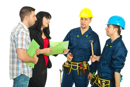 remodeling: Couple having conversation with workers team for renovating their house and holding folders isolated on white background