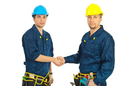 Team of constructor workers giving handshake isolated on white background photo