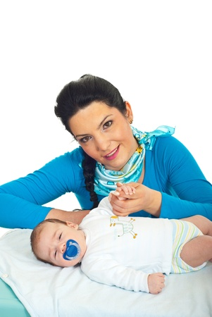 Happy attractive mother holding hand to her newborn baby boy against white background Stock Photo - 9166359