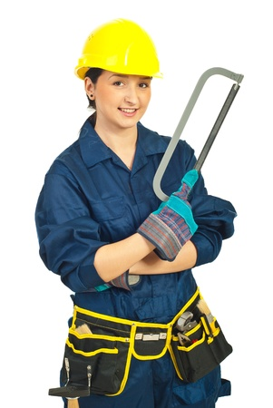 Happy young worker woman holding saw isolated on white background photo