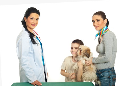 Family with puppy shih tzu visit veterinary doctor woman against white background Stock Photo - 9406548