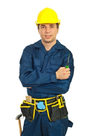 protective helmets: Young worker man holding screwdriver isolated on white background