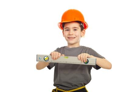 bubble level: Smiling kid boy holding bubble level isolated on white background Stock Photo