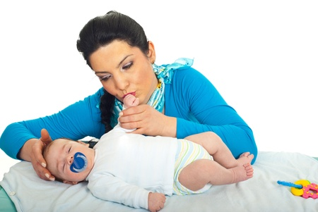 caress: Mother caress her newborn baby,kissing his hand and touching head