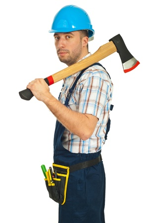 Serious worker man holding axe isolated on white background photo