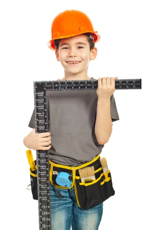 unifrom: Small boy in unifrom and helmet carry a L square ruler isolated on white background