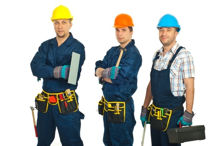 Constructor workers men team standing in a row isolated on white background photo