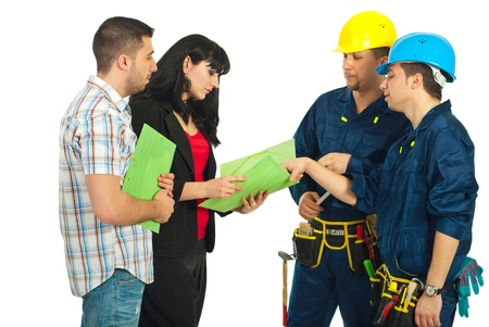 Repairmen team having discussion with a couple and looking together on folders with contract  photo