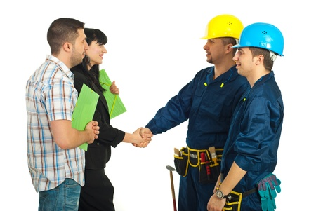 Family husband and wife giving handshake with workers men team against white background photo