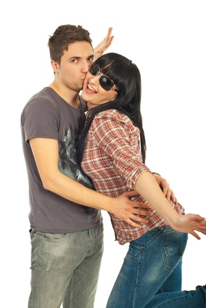 Loving young trendy couple isolated on white background photo
