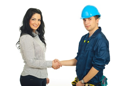 repairman: Happy constructor worker man and client woman giving handshake isolated on white background Stock Photo