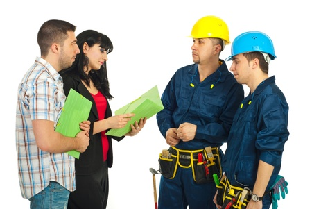 Couple reading a contract and making a deal with constructor workers team isolated on white background photo