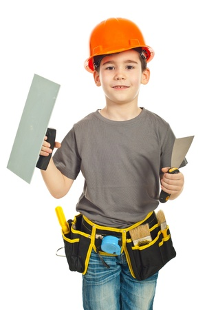 notched: Little boy with orange helmet holding notched and spatula against white background Stock Photo