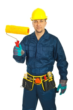 Midf adult worker man in unifrom holding paint roller isolated on white background photo