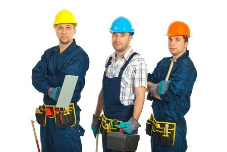 Team of constructor workers in a line holding tools isolated on white background Stock Photo - 9206942