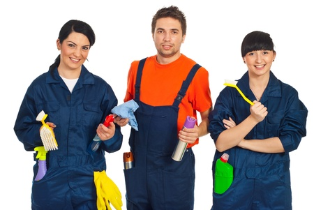 Team of three cleaning workers holding cleaning products isolated on white background