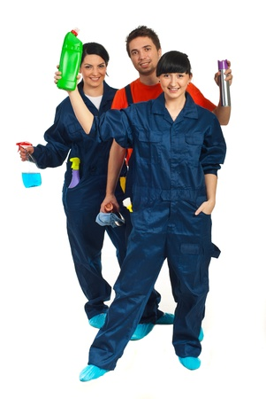 Full length of cheerful cleaning workers teamwork showing products isolated on white background photo