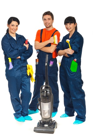 Team of workers people in a row offering cleaning service  isolated onw hite background Stock Photo