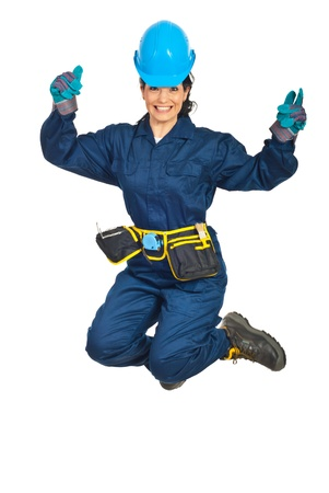 Happy constructor worker woman jumping isolated on white background Stock Photo - 9233721