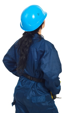 Back of constructor worker woman looking to copy space isolated on white background photo