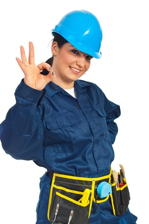 Happy constructor worker woman showing okay sign hand gesture isolated on white background Stock Photo - 9233767