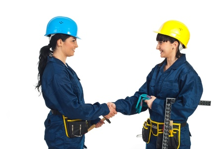 Happy constructor workers women giving handshake isolated on white background photo