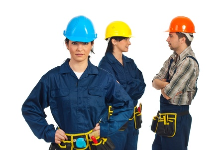 woman hard working: Constructor worker woman in front of camera  and her team of worker having conversation in background