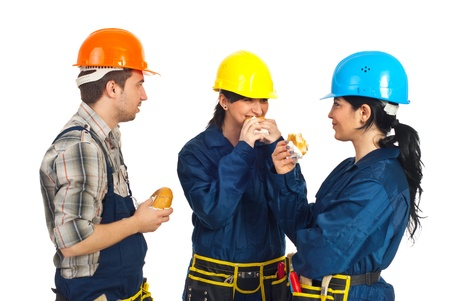 having a break: Team of three constructors workers in a break eating sandwiches and having conversation isolated on white background