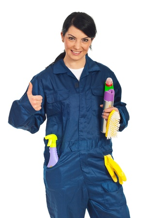 Successful cleaning worker woman holding cleaning products and giving thumb up isolated on white background photo