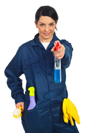 Cleaning worker woman holding spray bottle isolated on white background photo