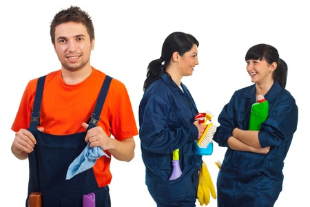 Happy teamwork of cleaning workers smiling  or laughing isolated on white background photo