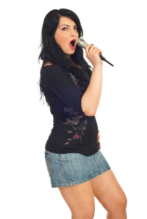 Elegant attractive woman singing with microphone isolated on white background photo