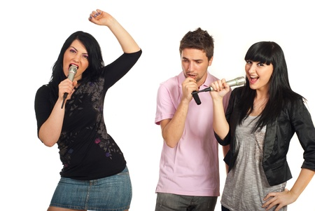 Group of three friends singing with microphones isolated on white background photo