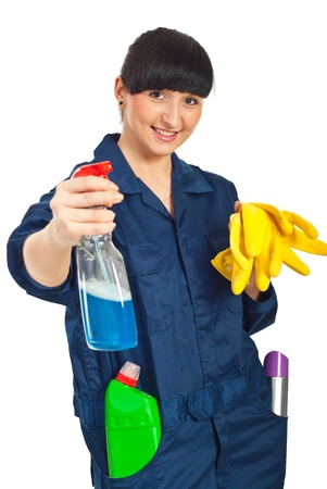 Cleaning worker woman holding cleaning products and being ready for work isolated on white background photo