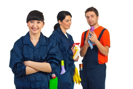 domestic workers: Happy cleaning service woman and her team isolated on white background Stock Photo