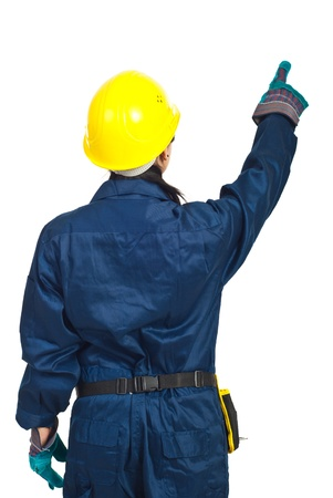 hard working woman: Back of worker woman pointing up  isolated on white background Stock Photo