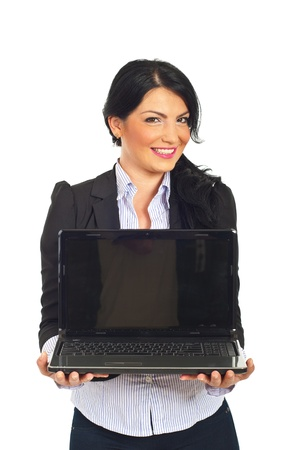 Happy business woman holding laptop with blank screen isolatedon white background photo