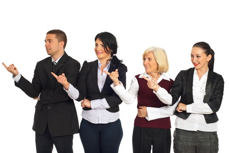 Four business people standing in a row and pointing together in left part of image isolated on white background photo