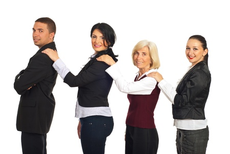 supporting: Four business people holding hands on each others shoulders and smiling ,concept of supporting each other isolated on white background