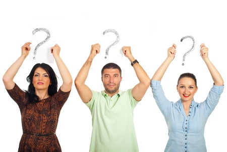 Three casual people standing in a line and holding questions marks  over their heads isolated on white background photo