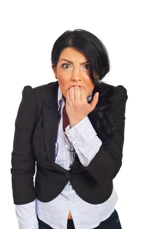 Very stressed and furious business woman biting her nails in front of camera isolated on white background photo