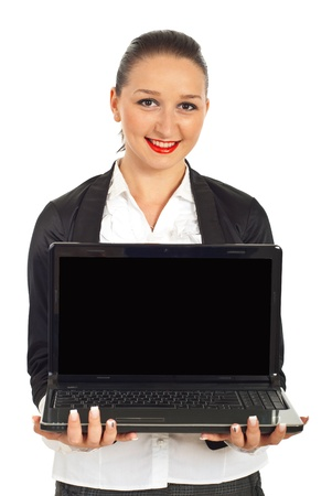 Happy young business woman holding laptop isolated on white background photo